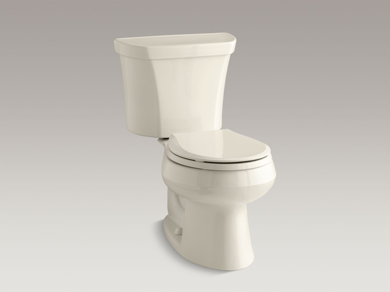 Kohler Wellworth® K-3987-RA-47 Wellworth® two-piece round-front dual-flush toilet with Class Five® flush technology and right-hand trip lever Almond